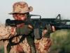 Американский солдат с карабином M4,  оснащенным 40-мм подствольным  гранатометом М203