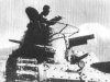 Японский танкист ведет огонь из пистолета «Nambu Type 14»