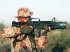 Американский пехотинец, вооруженный карабином М4А1 с установленным M203А1