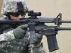 Американский солдат с дробовиком «XM-26 LSS» под стволом карабина «M4A1»
